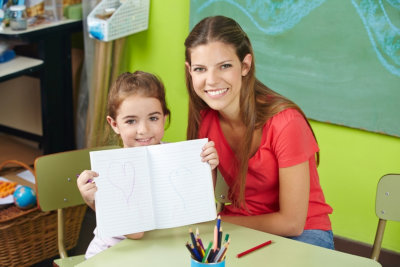 teacher and young girl smiling